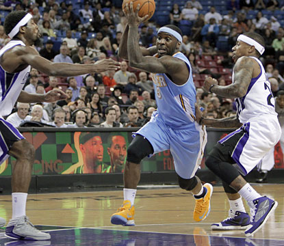 Ty Lawson helps keep the Nuggets in the win column as he produces 24 points and seven dimes. (AP)