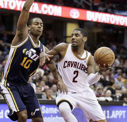 Kyrie Irving scores eight of his 20 points down the stretch to spark Cleveland's rally over the Jazz.  (AP)