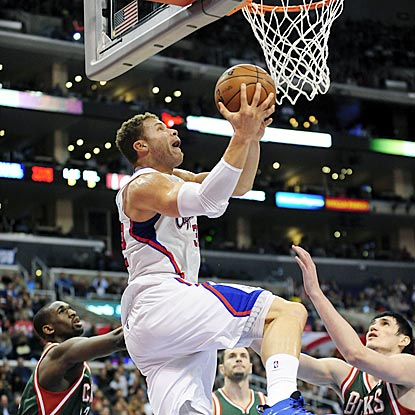 Blake Griffin soars for a reverse dunk in the first half while Milwaukee's Epke Udoh (left) and Ersan Ilyasova (right) look on. (AP)