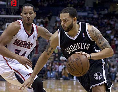 Deron Williams follows up his record-setting performance a night earlier with 17 points against Atlanta. (USATSI)