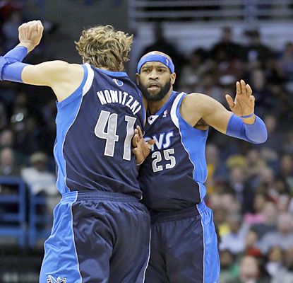 Dirk Nowitzki (19 points) and Vince Carter (23 points) do away with the Bucks to match their longest win streak of the season. (AP)