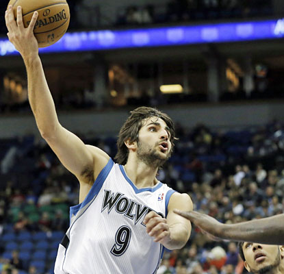 Ricky Rubio produces his first career triple-double with 21 points, 13 rebounds and 12 assists. (AP)