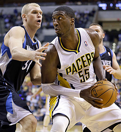 Roy Hibbert (right) scores a season-high 27 points and 12 rebounds to lead the Pacers to a win over the Timberwolves. (AP)