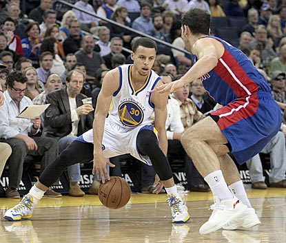Stephen Curry dribbles between his legs trying to elude Detroit's Jose Calderon during the third quarter.  (USATSI)