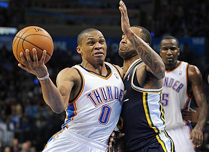 Russell Westbrook drives on Utah's Mo Williams during the first half, when he scores 13 of his 19 points. (USATSI)