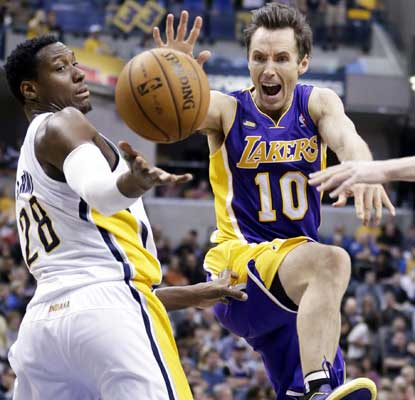 With Kobe Bryant held scoreless in just one quarter of play, Steve Nash and the rest of the Lakers pull out a gutsy win.  (AP)