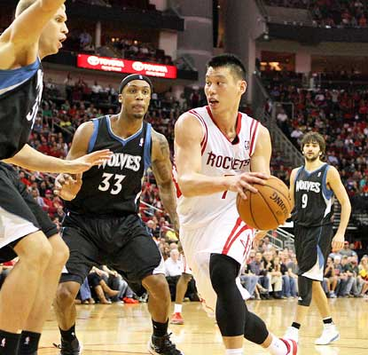 Jeremy Lin does his part in the Rockets comeback, scoring 24 points to help out star James Harden (not pictured).  (USATSI)