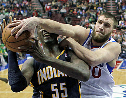 Philly's much-maligned center Spencer Hawes outplays Roy Hibbert, scoring 18 points and grabbing 16 rebounds. (AP)