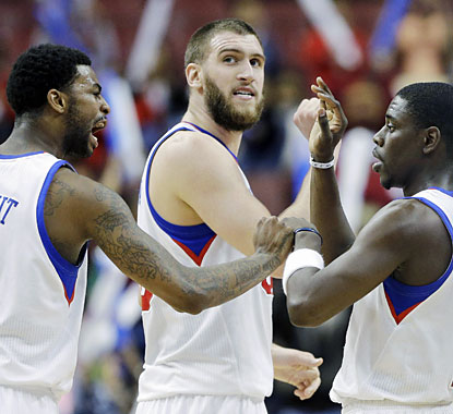 Dorell Wright, Spencer Hawes and Jrue Holiday combine for 61 points in the close win over Portland. (AP)