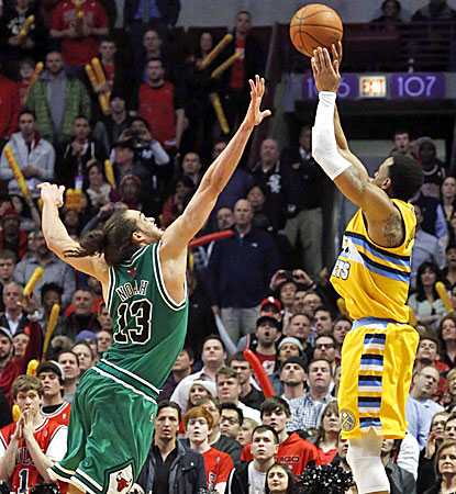 Andre Iguodala shoots the winning 3-pointer with 7.1 seconds left in overtime as Chicago's Joakim Noah tries to defend. (AP)