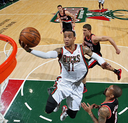 Monta Ellis fills the stat sheet as he puts up 21 points, nine boards, eight dimes, three steals and three blocks. (Getty Images)