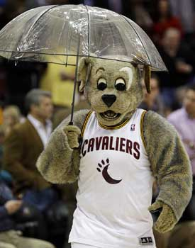 Moondog, the Cavs mascot, gets some protection from the scoreboard spill. (AP)