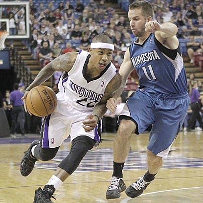 Sacramento's Isaiah Thomas, who leads all players with 24 points, drives on Minnesota's Jose Barea during the third quarter.  (AP)