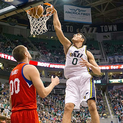 Utah's Enes Kanter throws one down with Philadelphia's Spencer Hawes out of position during the second half.  (USATSI)