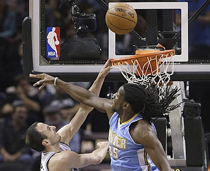 San Antonio's Manu Ginobili misses a dunk attempt in the fourth quarter while Denver's Kenneth Faried defends.  (AP)