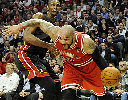 Chicago's Carlos Boozer scores 21 points and grabs 17 rebounds in the Bulls' win over the Miami Heat. (Getty Images)