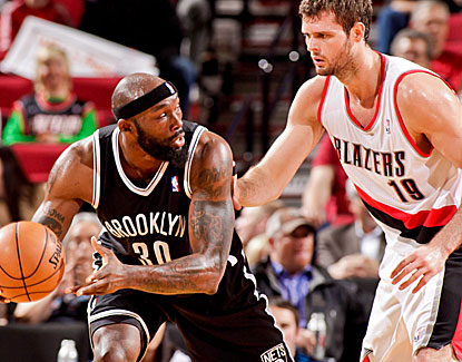 Brooklyn's Reggie Evans grabs a career-high 26 rebounds and matches his career high with 22 points. (Getty Images)