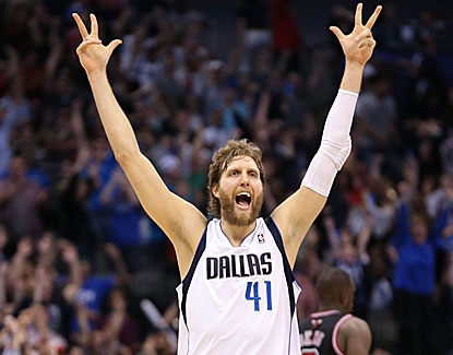 Dirk Nowitzki's 3-pointer with 2.9 seconds remaining sends the Mavericks to a come-from-behind win over Chicago. (USATSI)