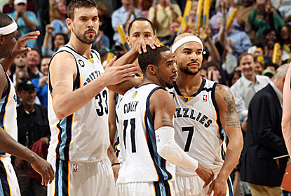 Mike Conley Jr. is congratulated by his teammates after hitting the game-winning shot for the Grizz. (Getty Images)