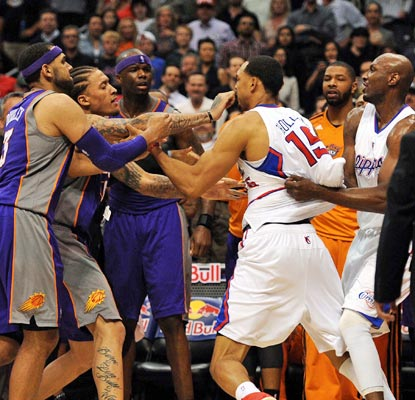 The Clippers and Suns get physical in the fourth quarter, resulting in an ejection for Ryan Hollins (15). (USATSI)