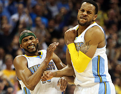 Denver's Corey Brewer (left) celebrates after Andre Iguodala hits the winner in the final seconds. (Getty Images)
