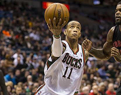 Monta Ellis scores 22 points with nine assists as the Bucks clinch their first playoff bid in three seasons. (USATSI)