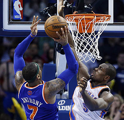 Carmelo Anthony gets around Serge Ibaka and the Thunder for 36 points and 12 rebounds as the Knicks leave OKC with a win. (AP)