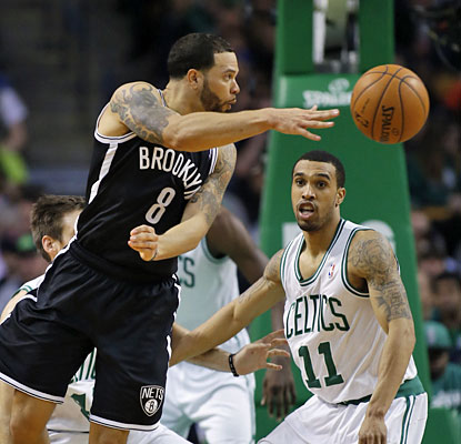 Deron Williams spreads out 12 assists and puts up 29 points as the Nets beat the Celtics for the third time this season. (USATSI)
