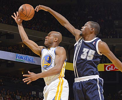 Kevin Durant swoops in from behind to block Jarrett Jack's shot. Durant winds up with a near-triple-double.  (Getty Images)
