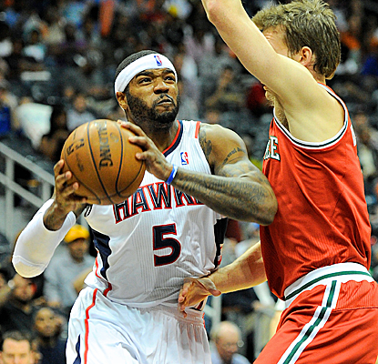 Josh Smith and Jeff Teague each score 24 points as the Hawks rally from a 19-point deficit to win.  (USATSI)