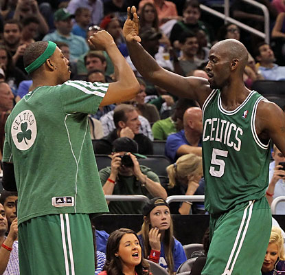 Kevin Garnett (right) finishes 7 of 8 from the field for 14 points -- one of seven Celtics to score in double digits. (USATSI)