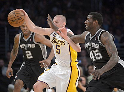 Steve Blake, shown stealing the ball from DeJuan Blair, winds up with 23 points in helping fill the void left by Kobe Bryant.  (USATSI)