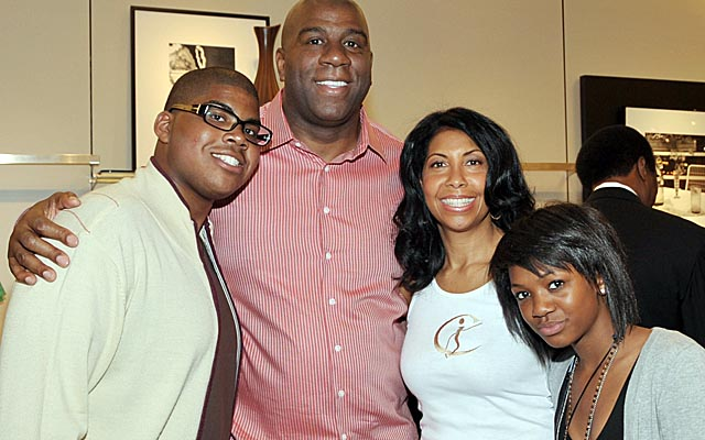 Magic Johnson poses with his son E.J., wife Cookie and daughter Elisa in 2009. (Getty Images)