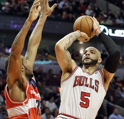 Carlos Boozer drops 19 points and 15 rebounds on the Wizards. His Bulls will face the Nets in the first round of the playoffs.  (AP)