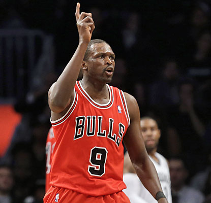 Luol Deng (15 points, 10 rebounds) helps the Bull become the first team to earn a road win this postseason. (AP)