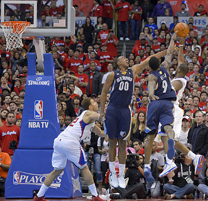 CP3 puts in a running jumper with 0.1 seconds remaining to give the Clippers a wild Game 2 victory. (AP)