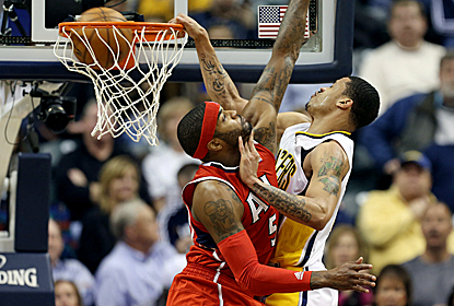 Gerald Green dunks all over Josh Smith as the Pacers win going away to take a 2-0 series lead.  (USATSI)