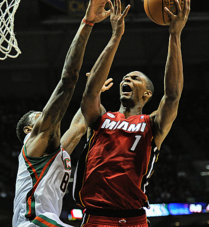 Chris Bosh posts a double-double with 16 points and 14 boards as the Heat cruise down the stretch.  (USATSI)