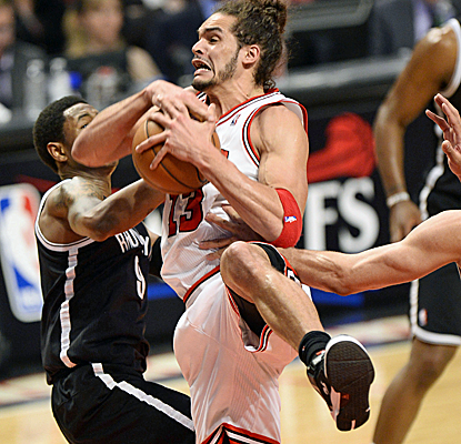 Joakim Noah battles for a rebound as the Bulls outlast the Nets to take a 2-1 series lead.  (USATSI)