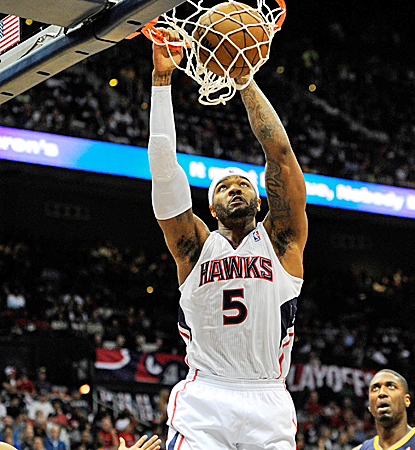 Josh Smith chips in 14 points as the Hawks creep back into the series with a big home win.  (USATSI)