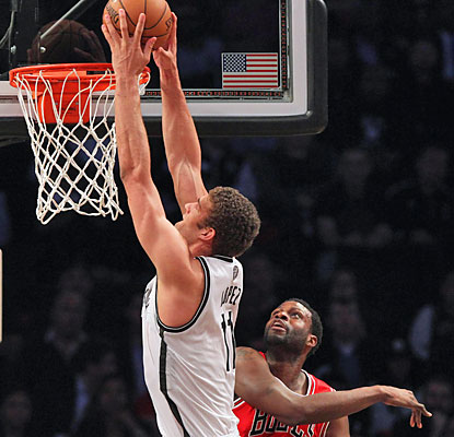 Brook Lopez hurts the Bulls with a 28-point, 10-board effort that helps the Nets keep their postseason alive. (USATSI)