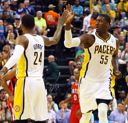 Paul George and Roy Hibbert have no problem beating the Hawks in Game 5. They're one win away from a trip to the second round.  (USATSI)