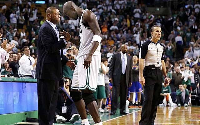 Kevin Garnett shakes hands with his coach after coming out of what may be his final game with the Celtics. (USATSI)