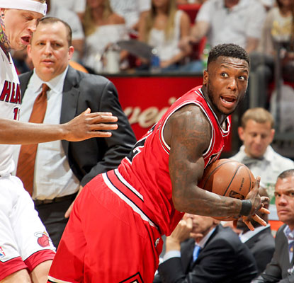 Nate Robinson overcomes a busted lip to score 27 points for the Bulls, who score the final 10 points to steal Game 1 in Miami. (Getty Images)