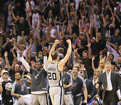 San Antonio fans erupt after Manu Ginobili nails the game-winning 3 with 1.2 seconds left in double overtime. (Getty Images)
