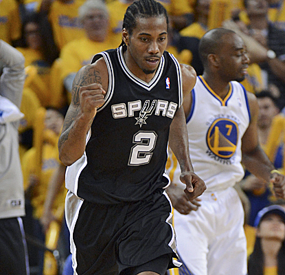 Kawhi Leonard posts a double-double, hitting huge shots down the stretch to help the Spurs advance. (USATSI)