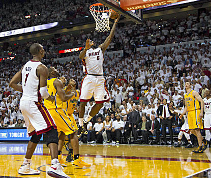 LeBron James goes up to score the winning basket during the final seconds of overtime against the Pacers. (USATSI)