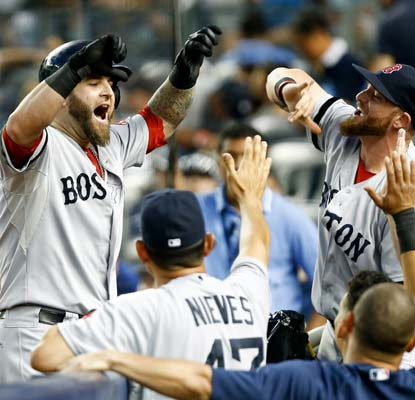 Mike Napoli makes the Yankees pay for intentionally walking David Ortiz by knocking a grand slam.  (USATSI)