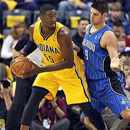 Roy Hibbert grabs a game-high 16 rebounds and scores 8 points to lead the Pacers in their season-opening win. (USATSI)