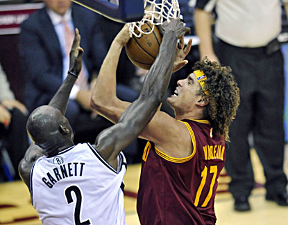 Cleveland center Anderson Varejao (right) beats Brooklyn forward Kevin Garnett for a rebound. (USATSI)